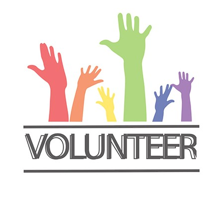 volunteer with colorful hands reaching up